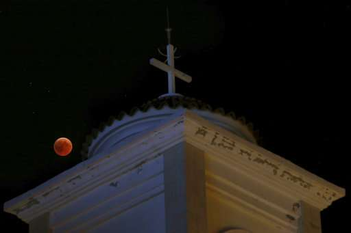 World looks at total lunar eclipse, longest of this century