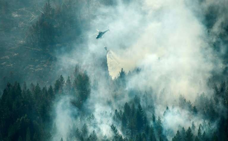 "Firefighters say they are putting out between ""20 and 30 wildfires per day"" near Stockholm while other blazes are ragi"