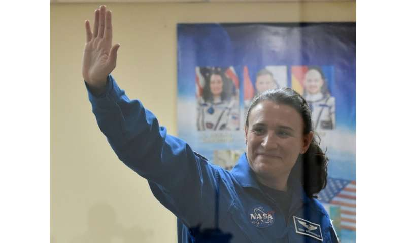 NASA astronaut Serena Aunon-Chancellor waves during a press conference at the Russian-leased Baikonur cosmodrome in Kazakhstan b
