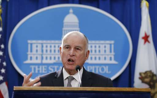 California sues over plan to scrap car emission standards