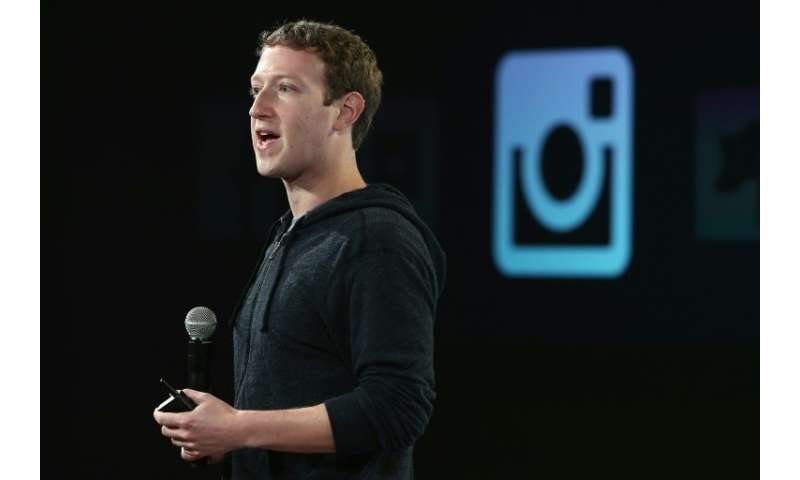 """Facebook CEO Mark Zuckerberg said the network will hire """"thousands"""" of new employees to verify the identity of politic"""