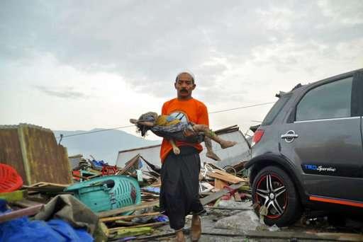 Indonesian quake and tsunami devastates coast, many victims