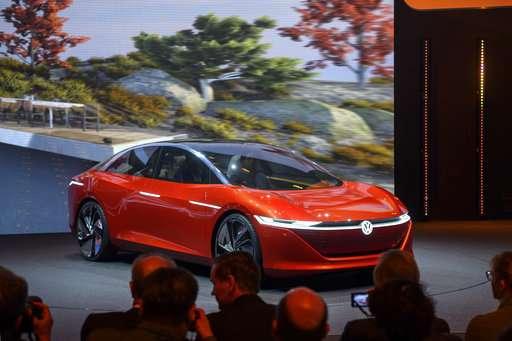Geneva car show: electrics buzz but gas-guzzlers still shine