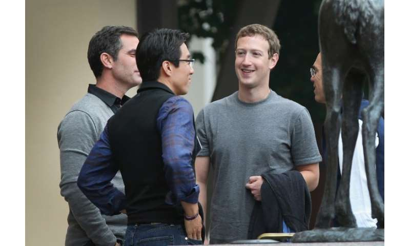 Mark Zuckerberg has followed in Steve Jobs' sartorial footsteps, sporting a plain grey T-shirt every day for years
