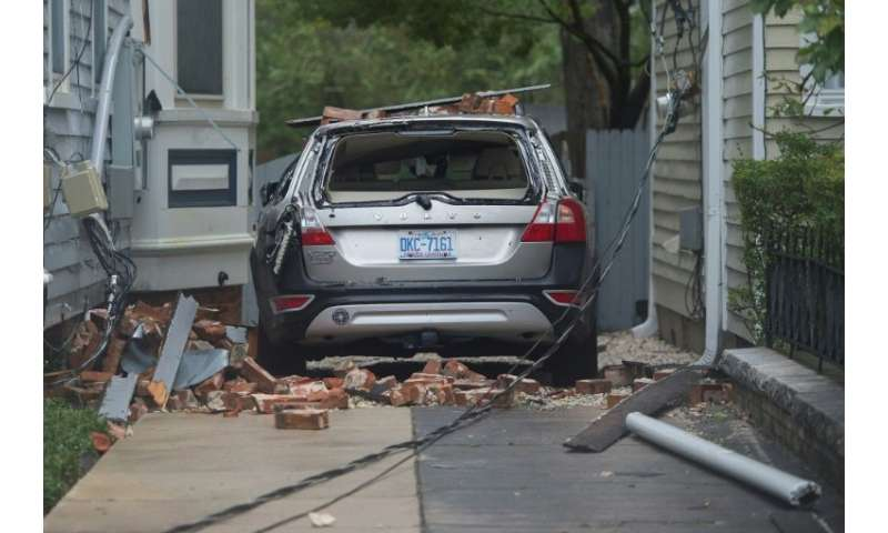 A car destroyed by falling bricks as Hurricane Florence passes over Wilmington, North Carolina