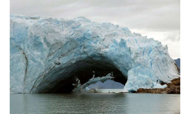 A chunk of ice falls from a famous bridge that formed in a glacier at the tip of Argentina