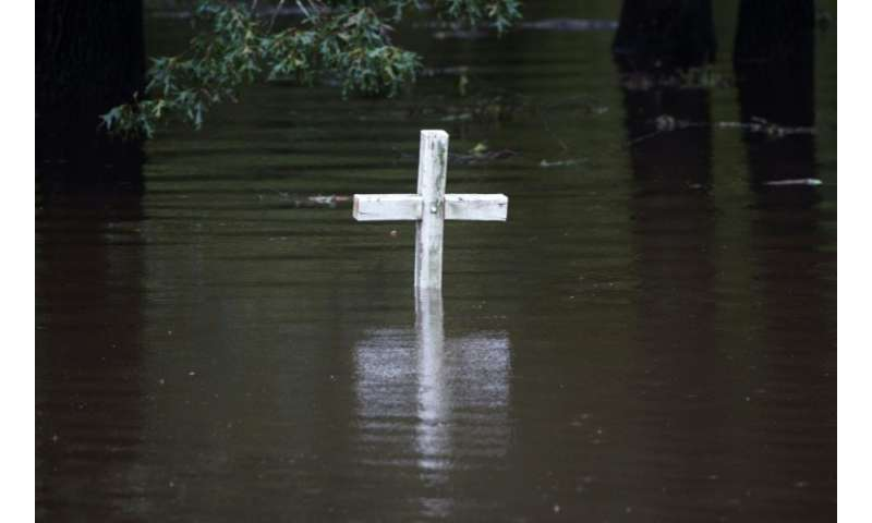 A cross is seen in flood water at a cemetery in Grifton, North Carolina