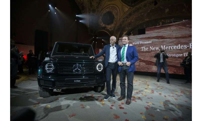 Actor and former California Governor Arnold Schwarzenegger (R) takes part in the unveilling of the new  Mercedes G-Class at the