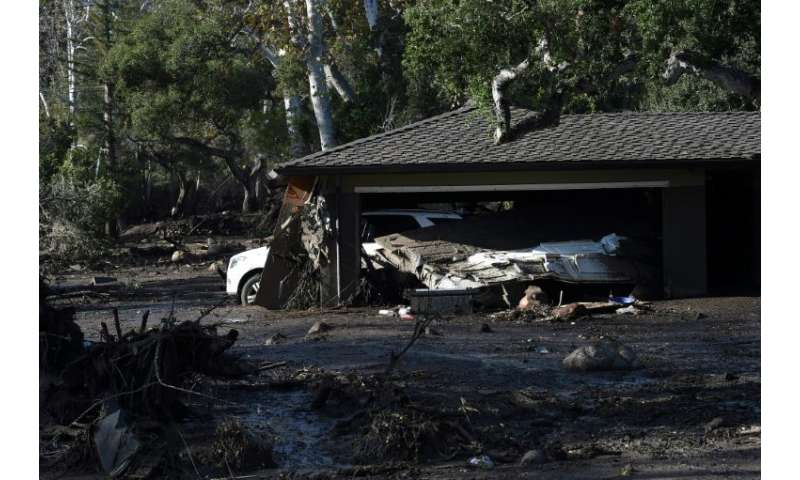 A home is surrounded by mud and debris caused by a massive mudslide in Montecito, California