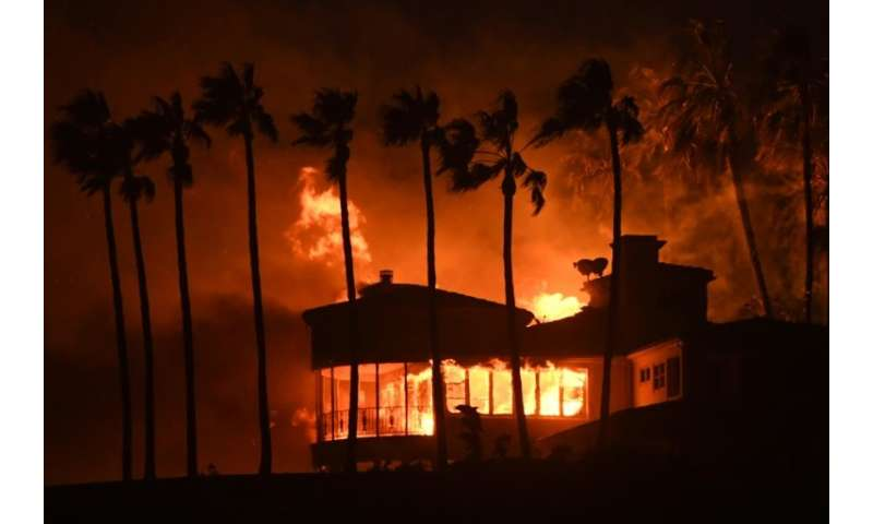 A house burns in the Hollywood resort town of Malibu—about 88,000 homes have been evacuated in Los Angeles and Ventura counties