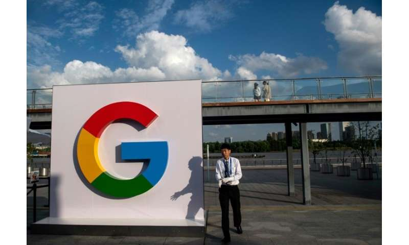 A man passes a Google sign in Shanghai on  September 26, 2018. Google announced that it will test a video game streaming platfor