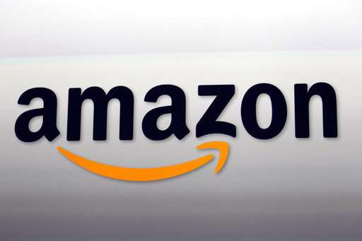 """Amazon partners with Best Buy on smart TVs, a """"win-win"""""""