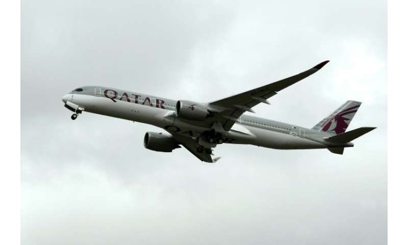 An A350 of Qatar Airways is pictured on October 19, 2017, after taking off from the Toulouse-Blagnac airport, near Toulouse
