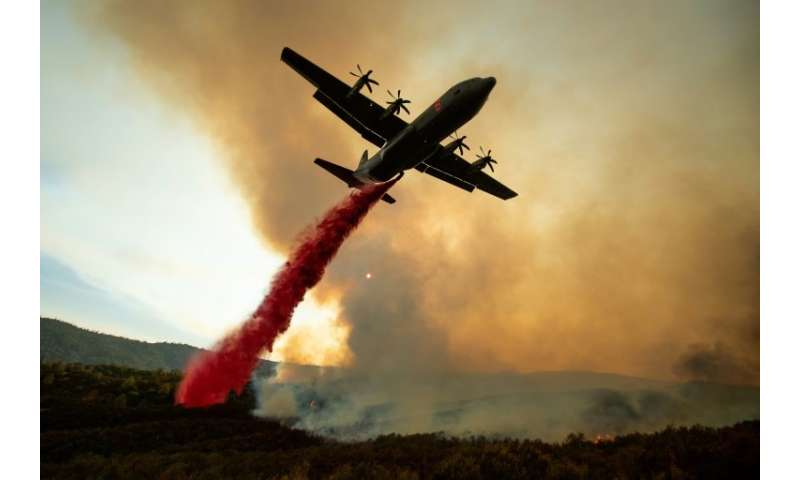 An air tanker drops retardant on the Ranch Fire, part of the Mendocino Complex