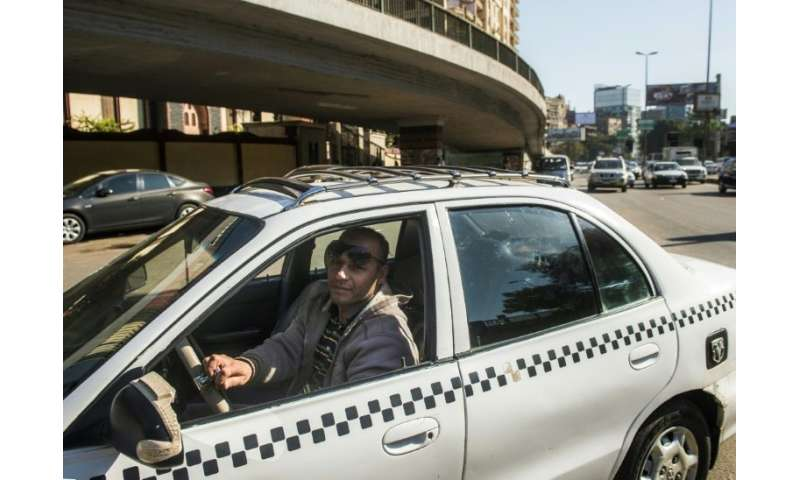 An Egyptian taxi driver navigates the streets of Cairo on November 7, 2016