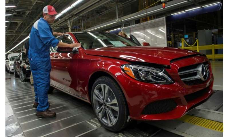 47d2375e91 An employee conducting a final inspection on a Mercedes-Benz C-Class at the  Mercedes-Benz US International factory in Vance
