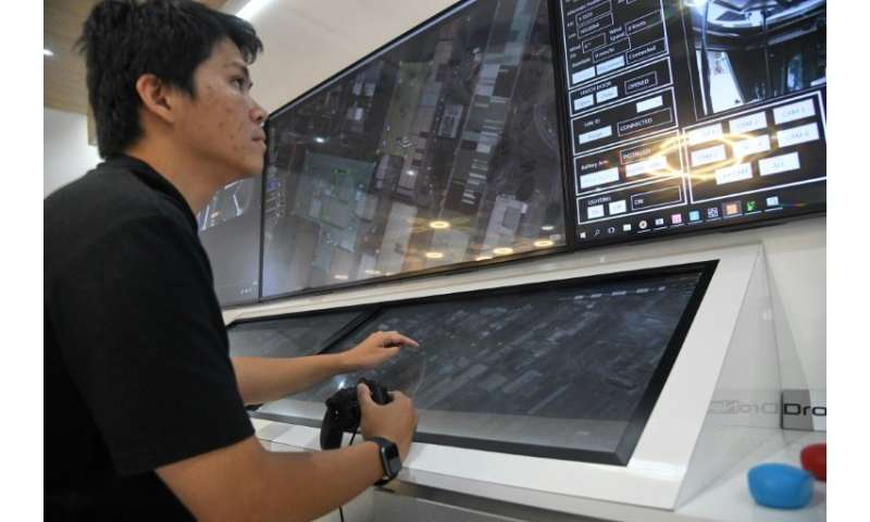 An engineer monitors a live video feed sent by a surveillance drone at a command centre in Singapore