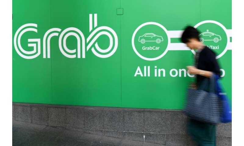 Singapore watchdog fines Grab, Uber $9 5 mn over merger