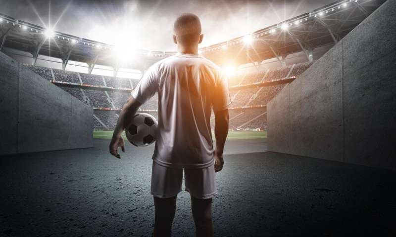 A psychological theory to explain how music helps footballers prepare for the pitch
