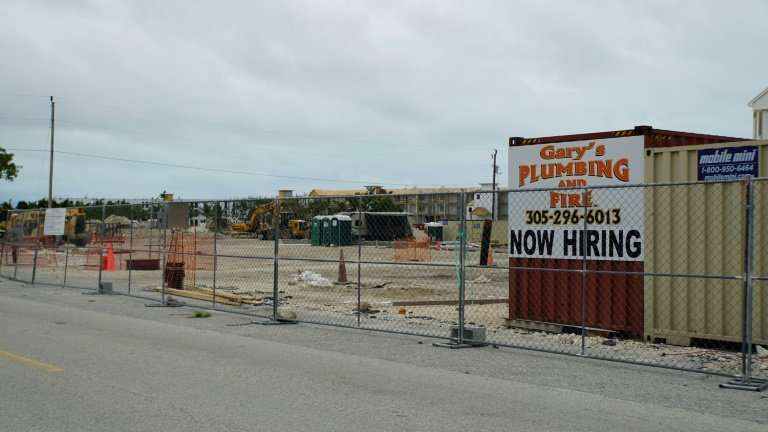 "A ""now hiring"" sign in a construction area in the Florida Keys, which is still struggling to rebuild after being pumme"