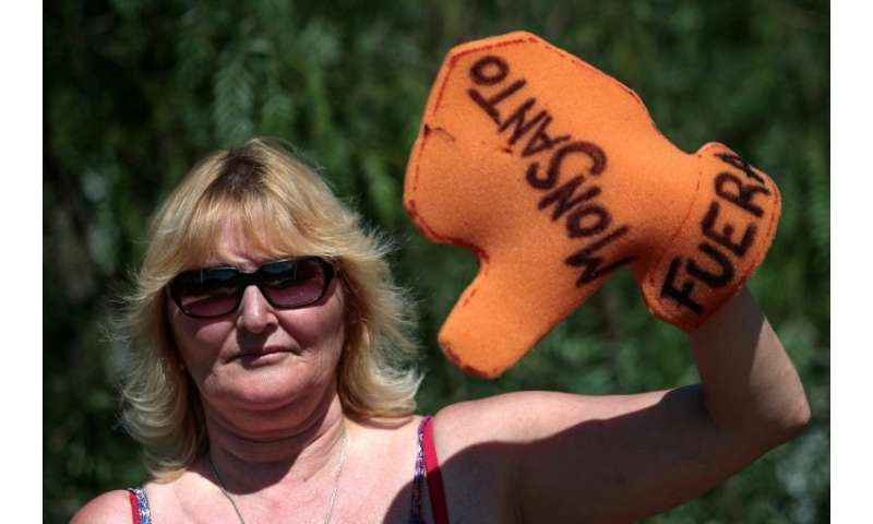"Argentine environmentalist Sofia Gatica poses with a glove reading ""Monsanto out,"" as she protests against the use of"