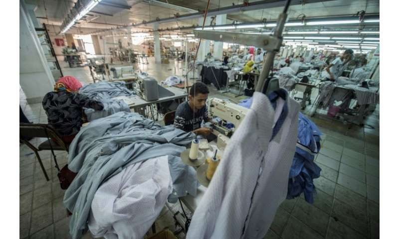A tailor sews cotton shirts at the Marie Louis clothing and textile factory in the 10th of Ramadan city, about 60 kilometres nor