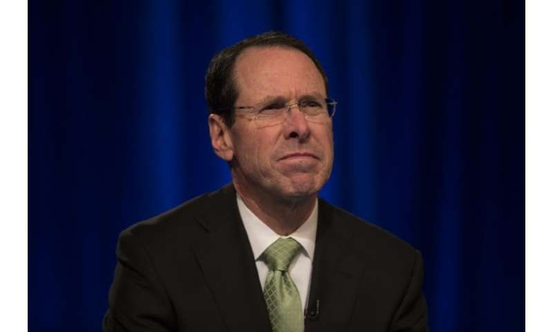 AT&T chairman and CEO Randall Stephenson is fighting a Justice Department bid to block the telecom giant's merger with Time