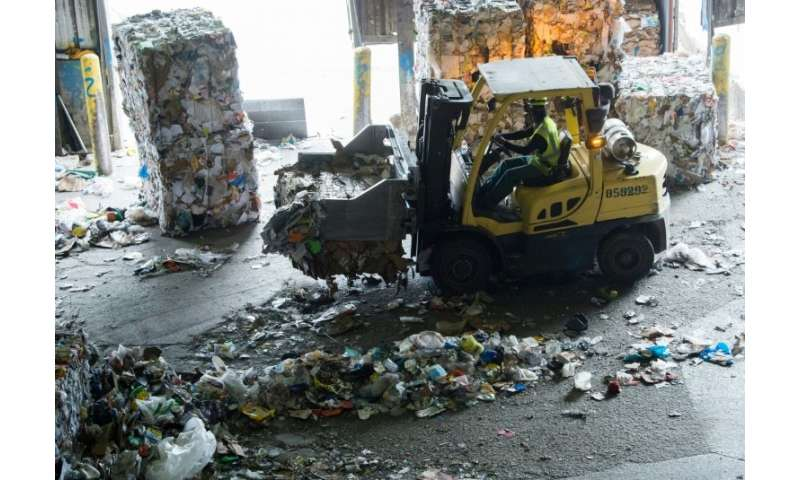 At a recycling facility in the Baltimore-Washington area, bales of compacted plastics and paper are cluttering the plant because
