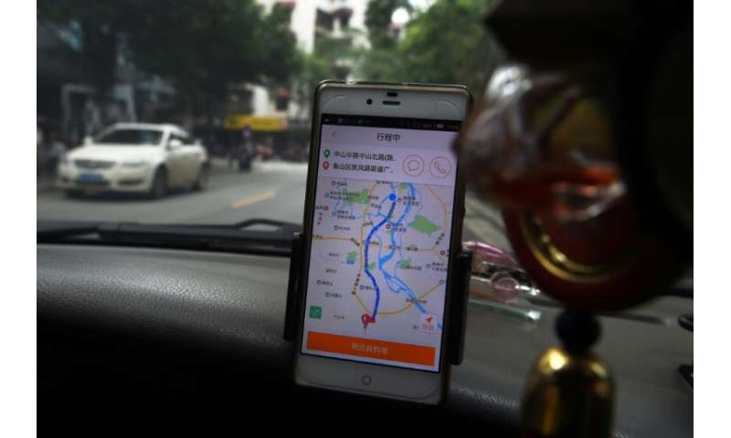 A taxi driver uses the Didi Chuxing app in China: the firm has now launched in Melbourne as it bids for global business