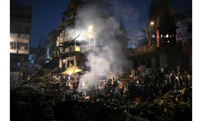 Boats loaded with wood arrive almost constantly at the famous ghats of Varanasi for around 200 cremations per day.