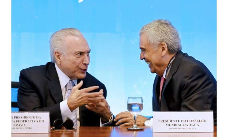 Brazilian President Michel Temer (L), seen here talking to the president of the World Water Council, Benedito Braga, is hosting