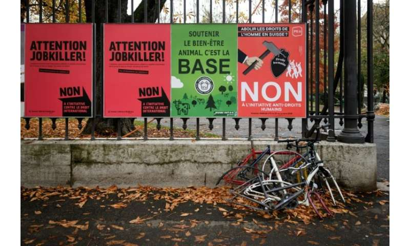 Campaign posters in Geneva draw attention to the three issues on which Swiss are called to vote—including safeguarding cow horns