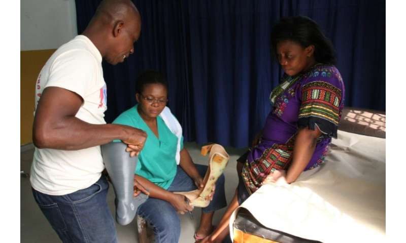 Car accident victim Adjovi Koudahe, 46, says she has 'high hopes' for her 3D-printed orthotic leg brace, here being fitted at To
