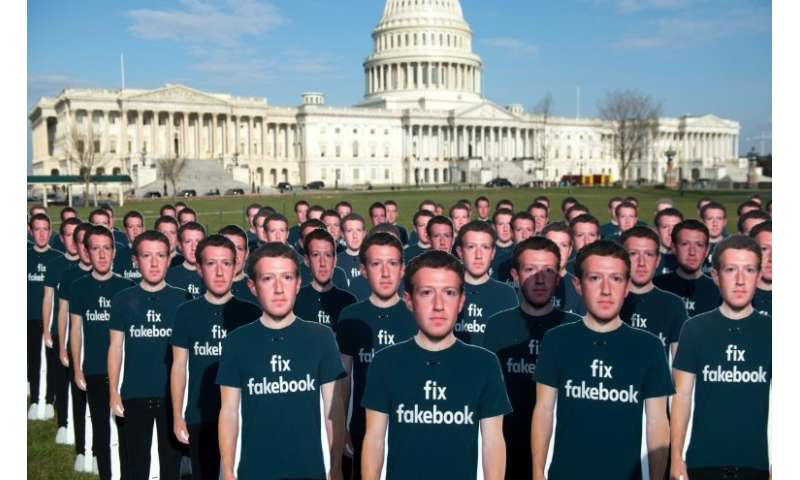 Cardboard cutouts of Facebook CEO Mark Zuckerberg stand outside the US Capitol, placed by advocacy group Avaaz to call attention