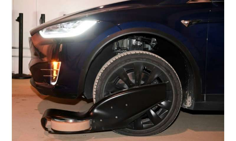 Cars are fitted with tracking wheels which stabilize the vehicle on a track allowing them to travel at high speed through a tunn