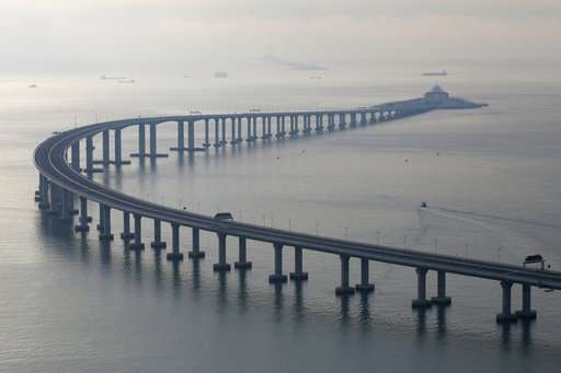 China opens mega-bridge linking Hong Kong to mainland