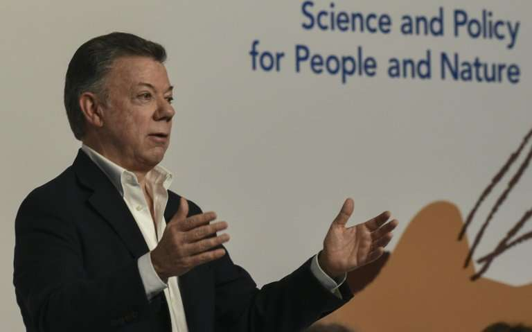 Colombian President Juan Manuel Santos delivers a speech during the opening of the sixth plenary session of the Intergovernmenta