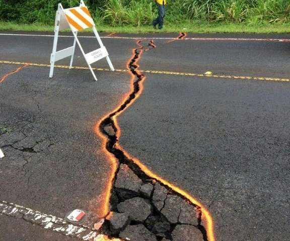 Cracks in Highway 130 outlined in orange at Leilani Estates, Hawaii
