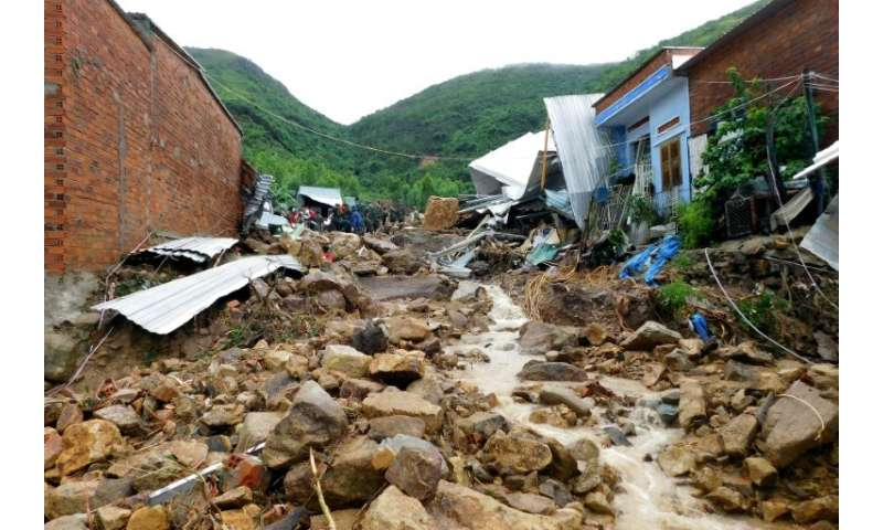 Damaged houses and debris were left by flash floods and landslides in the Phuoc Dong commune of central Vietnam's Khanh Hoa prov