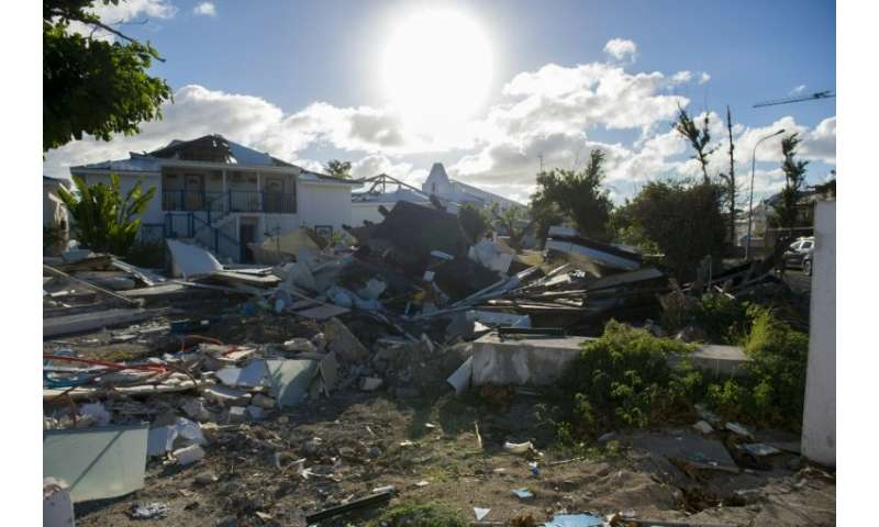 Debris-strewn Nettle Bay on Saint-Martin, as authorities and construction companies press on with a mass clean-up operation befo