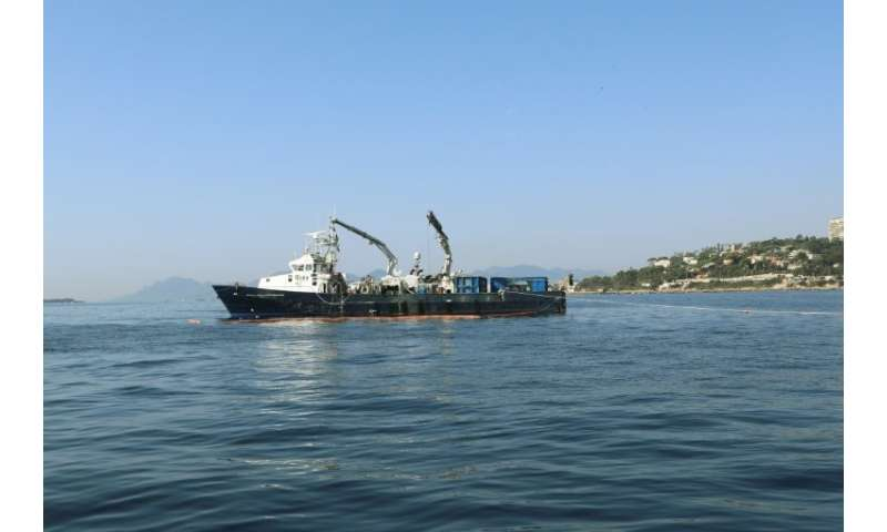 Divers and a specially equipped boat with lifting gear have been fishing out hundreds of the old rubber tyres 500 metres (1,600