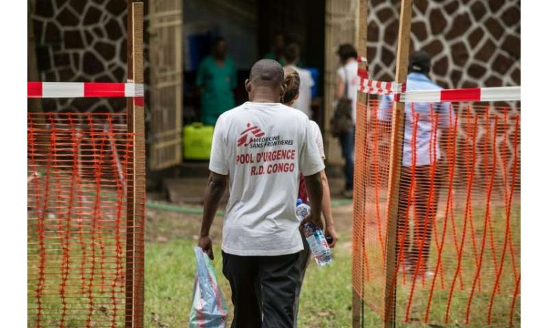 Doctors Without Borders team members (pictured May 2018) walk through an Ebola security zone at the entrance of a hospital in DR