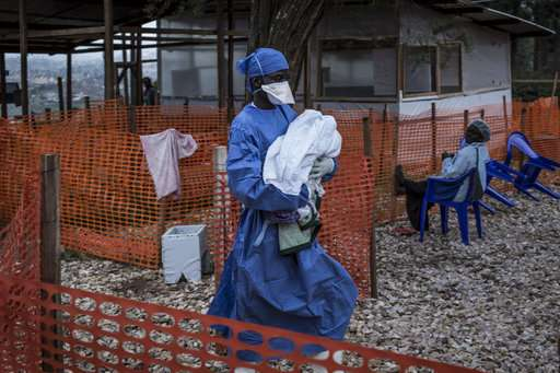 Ebola spreads to major Congo city as vaccines a concern