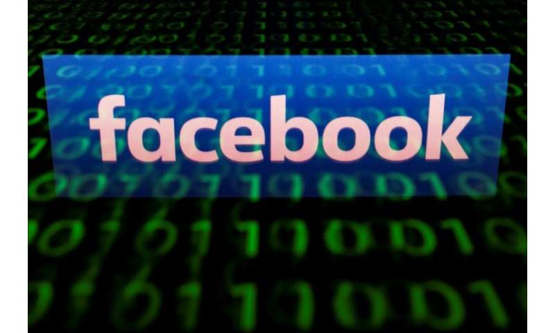 (FILES)  A file illustration picture taken on April 28, 2018 shows the logo of social network Facebook displayed on a screen and