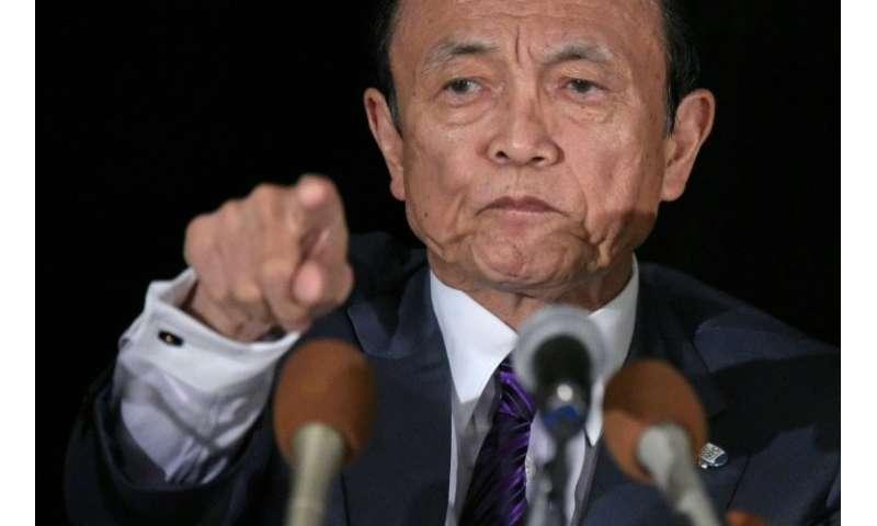 "Finance Minister Taro Aso said the raids were being carried out on exchanges to ""examine their internal governance structur"