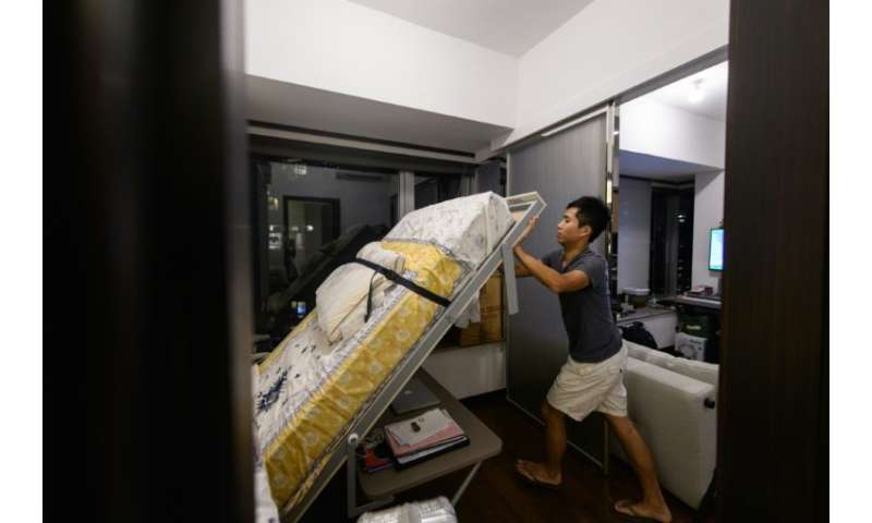 Finance worker Adrian Law, 25, paid more than US$765,000 for his 292 square foot (27 square metre) studio flat