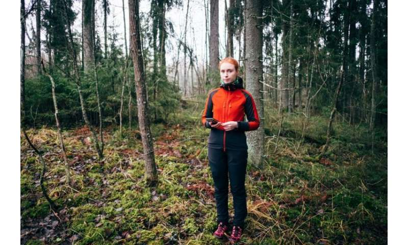 Finnish conservation expert Inna Salminen relies on her phone for her work in the forests