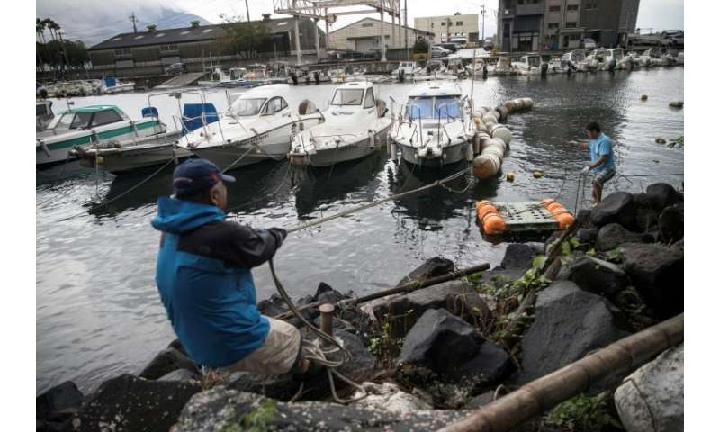 Fisherman made preparations for approaching Typhoon Tramiby by tying down their boats