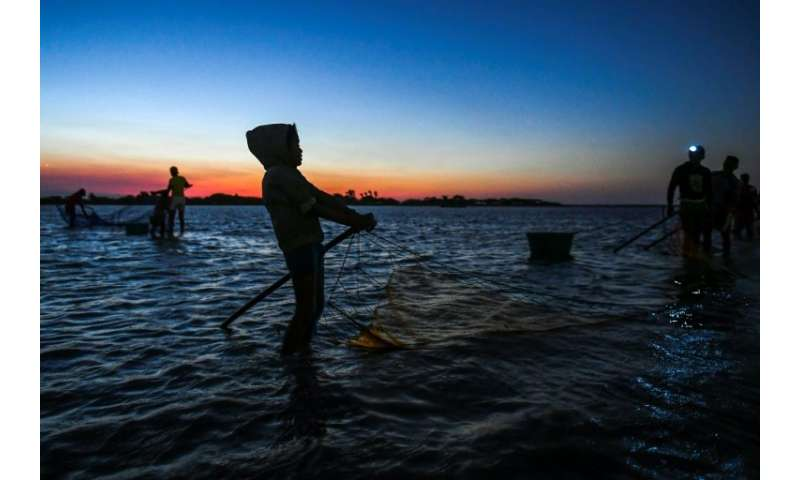 Fishing for shrimps at the Navio Quebrado lagoon in northern Colombia has gotten harder as pollution and climate change have red