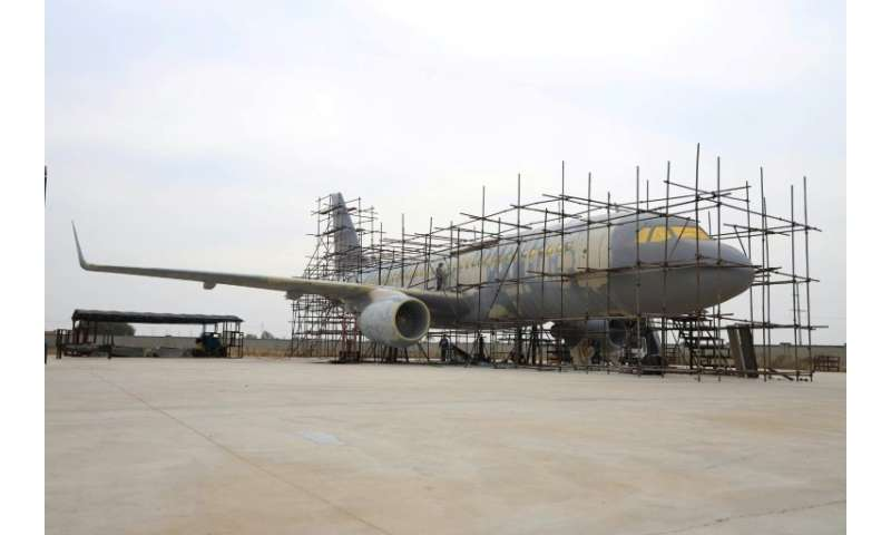 Five fellow aircraft enthusiasts have helped Zhu Yue speed the project along